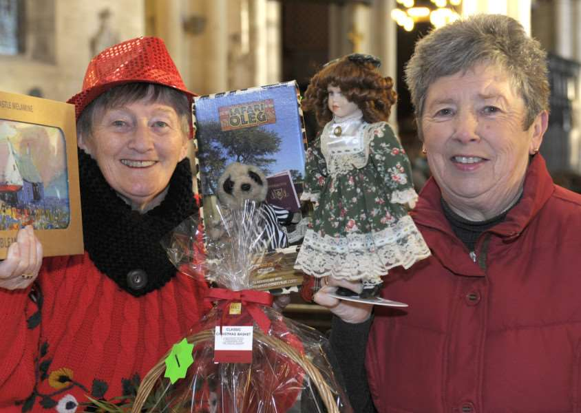 King's Lynn Minster Christmas Fayre to be opened by Borough Deputy Mayor Jim Moriarty 'LtoR, Raffle Stall, Brenda Steel and Brenda Futter (Church Warden)