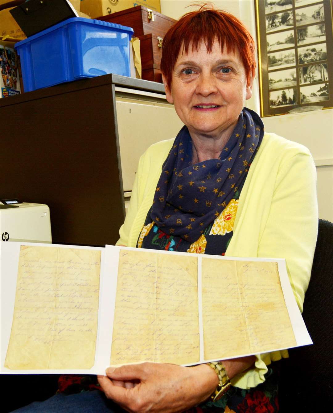 Visitor Sandra Howard with a copy of the letter from the front line at Amiens announcing the World War One death of a 23-year-old Docking soldier
