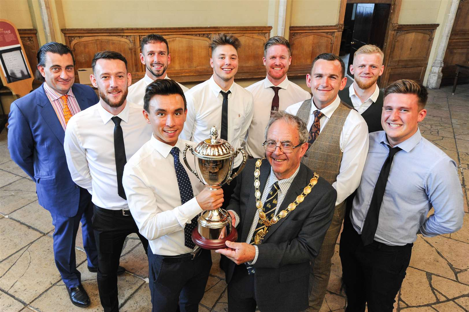 A Civic reception was held at the Town Hall to celebrate King's Lynn Town FC's promotion. Pictured with the trophy are club captain Michael Clunan and West Norfolk Mayor Geoff Hipperson. Back row (from left) Owner Stephen Cleeve, Ross McAuley, Ryan Fryatt, Ryan Hawkins, Michael Gash, Alex Street, Frazer Blake-Tracy and Charlie Congreve. (11088399)