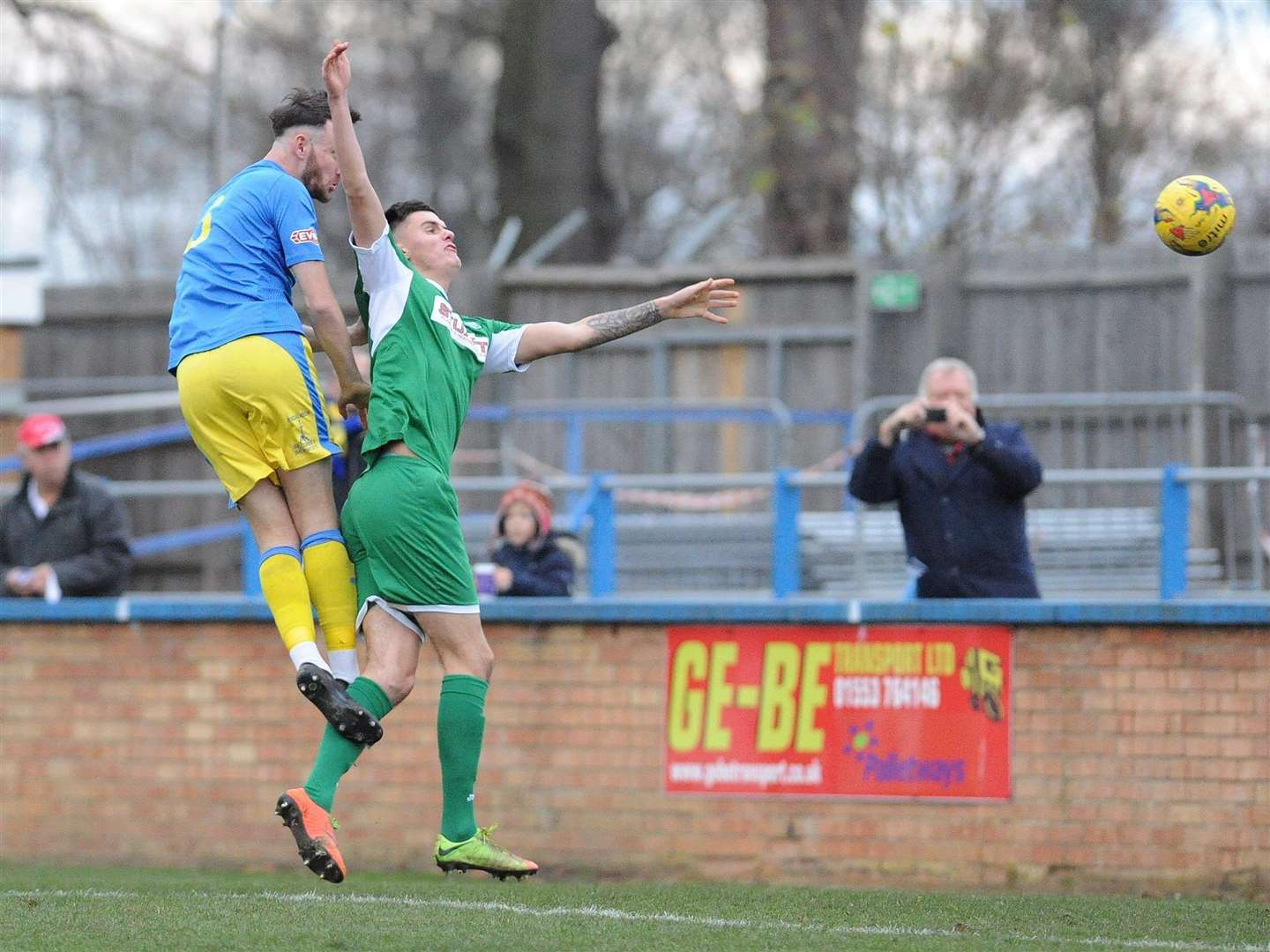 Rory McAuley stoops to head Lynn in front against Bedworth United at The Walks. Picture: TIM SMITH (5594925)