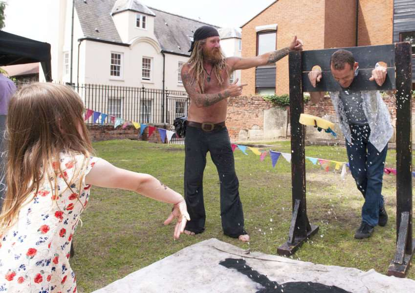 Sea Funday and Competition a True'es Yard Fisherfolk Museum King's Lynn Pictured throwing the wet sponge Amaya Cahill to in the stocks Martin Gardner.