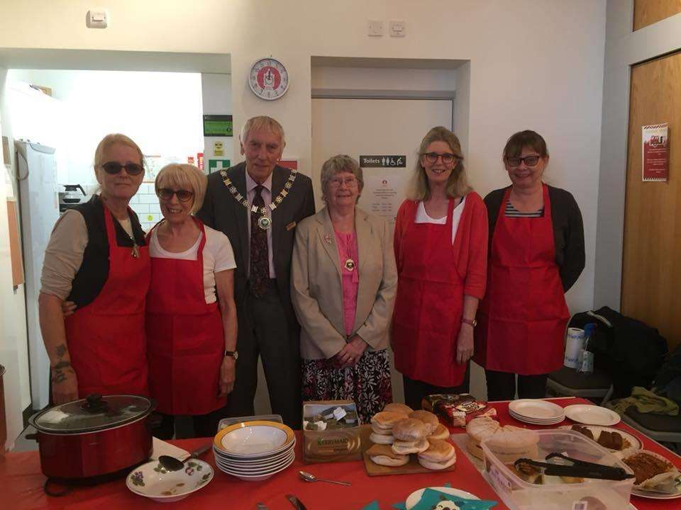 Volunteers at Downham Market Community Cafe with town deputy mayor John Doyle. Photo: SUBMITTED. (4090442)