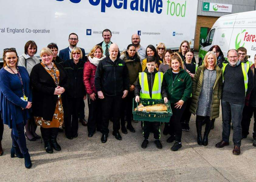 Representatives from Central England Co-op and FareShare come together to celebrate the success of the pilot project to tackle food waste.