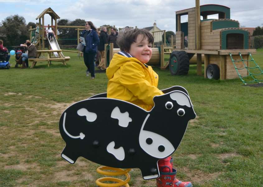 Three-year-old Harry Bennetts tries out a Springer ride in Burnham Market's new play area