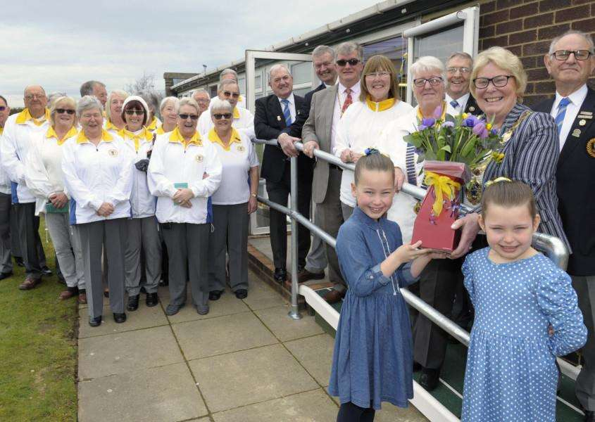 Borough Mayor Opening Newly-Refurbished Clubhouse at King's Lynn Bowls Club.''Mayor Carol Bower being presented with flowers by LtoR, Nancy Rutty (8) and her sister Edith Rutty (7), also in pic Mayor's Consort Simon Bower along with club officials and members