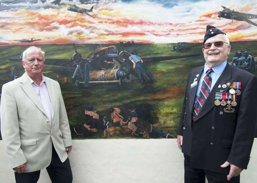 Unveiling of new 60ft mural. Wellington Public House Feltwell. Pictured FLtoR Artist Colin Mason. Veteran Ivan Potter.