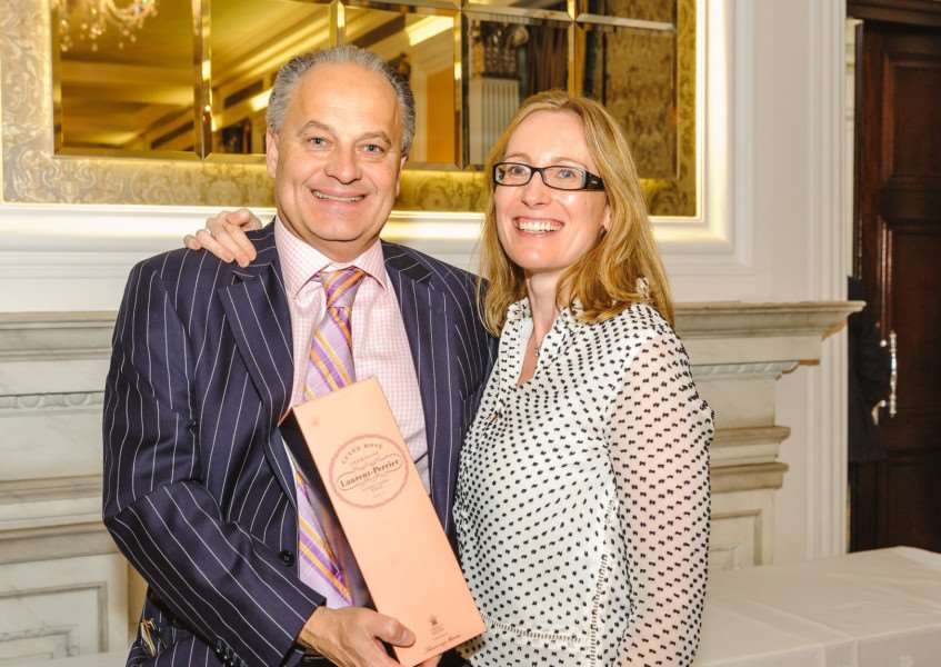 Paul Bedford, managing partner at Bedfords, receives his award from Rowena Kenny, of Four Media.