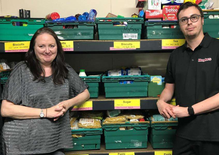 Pictured are: Foodbank Distribution Centre Coordinator Alex Coates and Aaron Beck, of Hughes Electrical. Photo: SUBMITTED.