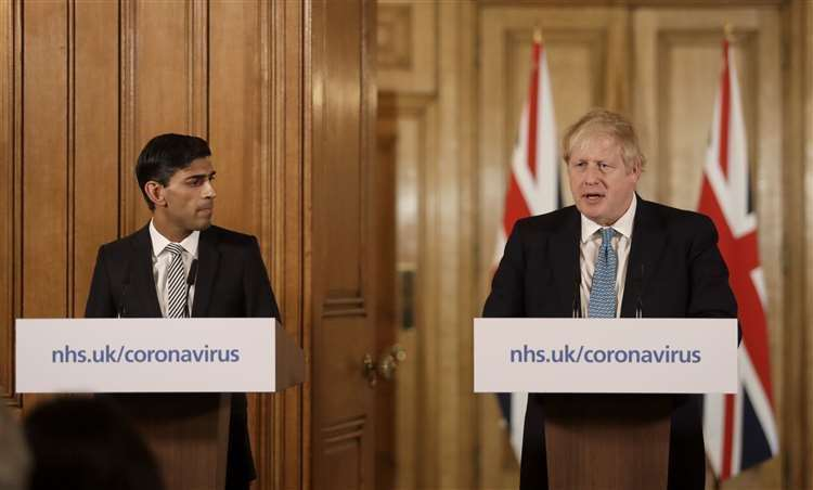 Prime Minister Boris Johnson and Chancellor Rishi Sunak, are fighting to ease the financial burden for households as a result of the crisis. Picture: Matt Dunham/PA Wire (32215320)