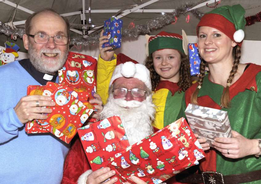 Christmas Fair at Downham Market Methodist Church.'LtoR, Rev Maurice Stafford, with Father Christmas and Elf's Morgan and Emma Estep at the Fair