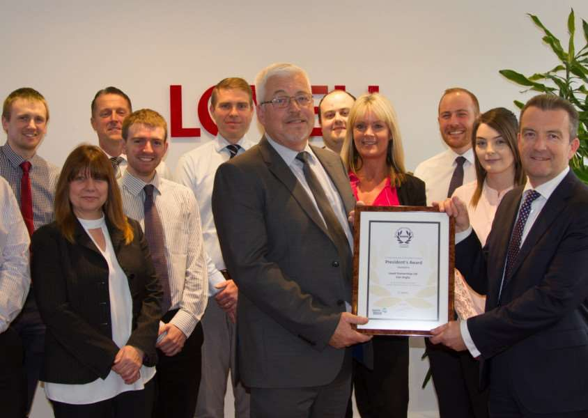 Pictured holding the award certificate are Lovell regional managing director Simon Medler (on right) and regional health, safety and environment manager Glenn Whitten (on left) with some of the Lovell team in East Anglia.