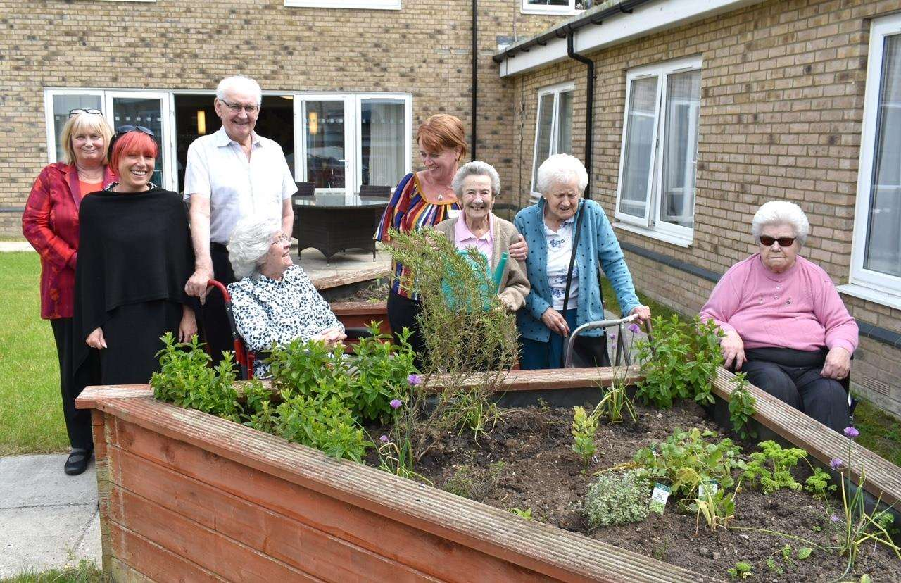 Downham Grange manager Dani gaston, front left in black with staff, residents and their relatives (2257782)