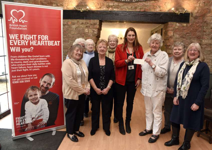 Golden Girls presenting a cheque for �3,700 to heart foundation at The Barn Restaurant Terrington St John'Holding the cheque left to right Dawne Hart and Maggie Butler with cheque