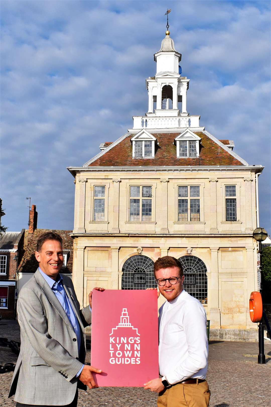 Jason Fuller and Ivor Rowlands with the Town Guides' new logo, outside the Custom House. (8491891)