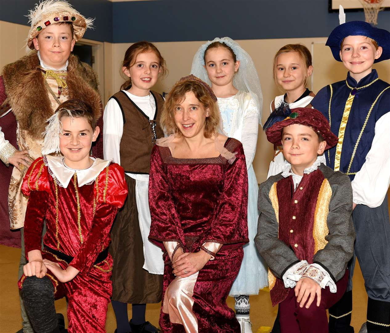 History day at Denver Primary School, each class has been given a different period of British History to explore (i.e. Stone Age, Victorian Britain, The Iron Age and the Tudors)...Pupils form Class 4 Year 5/6 Tudors, they are pictured with Class Teacher Dawn Henden... (22463911)