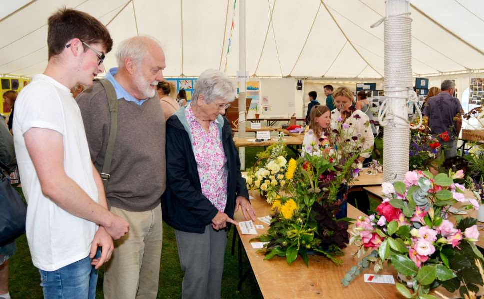 BURNHAM MARKET FLOWER SHOW AND CARNIVAL'Jack Broughton and Trevor and Anne Manning cast their eyes over some of the flower arranging entries