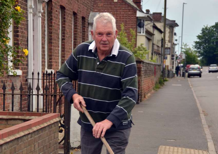 Sutton Bridge, John Grimwood for Guardian feature'John sweeps pavements and empties bins that he fixed to bus shelter