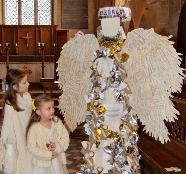 HARPLEY CHURCH ANGEL FESTIVAL'Hattie and Heidi Gould, two of the many Harpley primary school pupils who helped make this life size angel