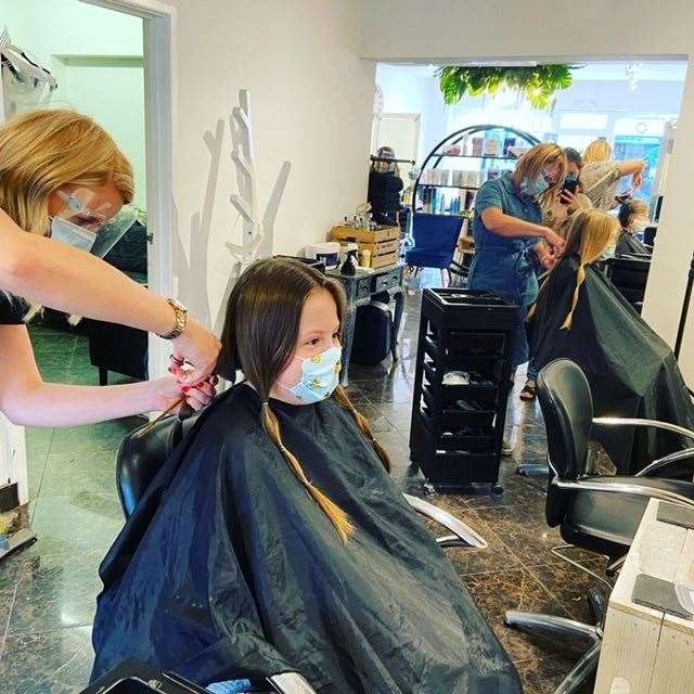 Amelia having her hair cut off to be donated to the Little Princess Trust. Picture: SUBMITTED