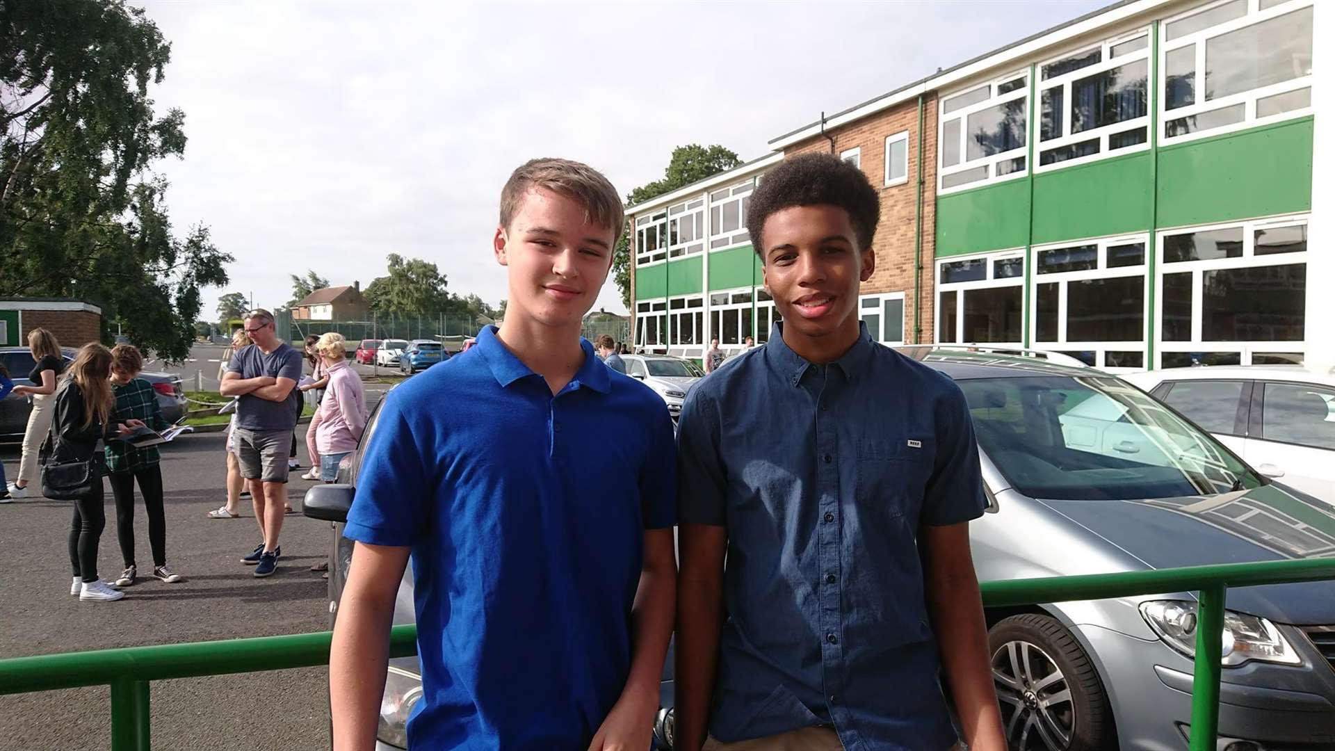 Daniel Plumb (One grade 9, two grade 8s and four grade 7s) with Ezra Nwobodo, pictured right