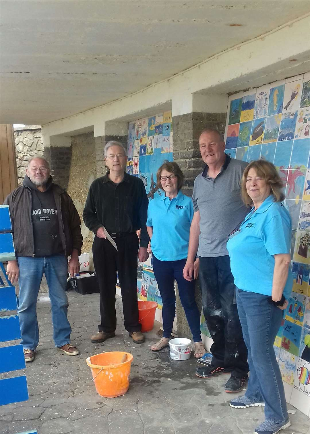 Christine Earnshaw, chair of the HDFA, thanked Martin Turner, Chris Ellis, Jim Worley andMike Sherwood of Hunstanton Men's Shed for installing the new tiles. Picture: SUBMITTED
