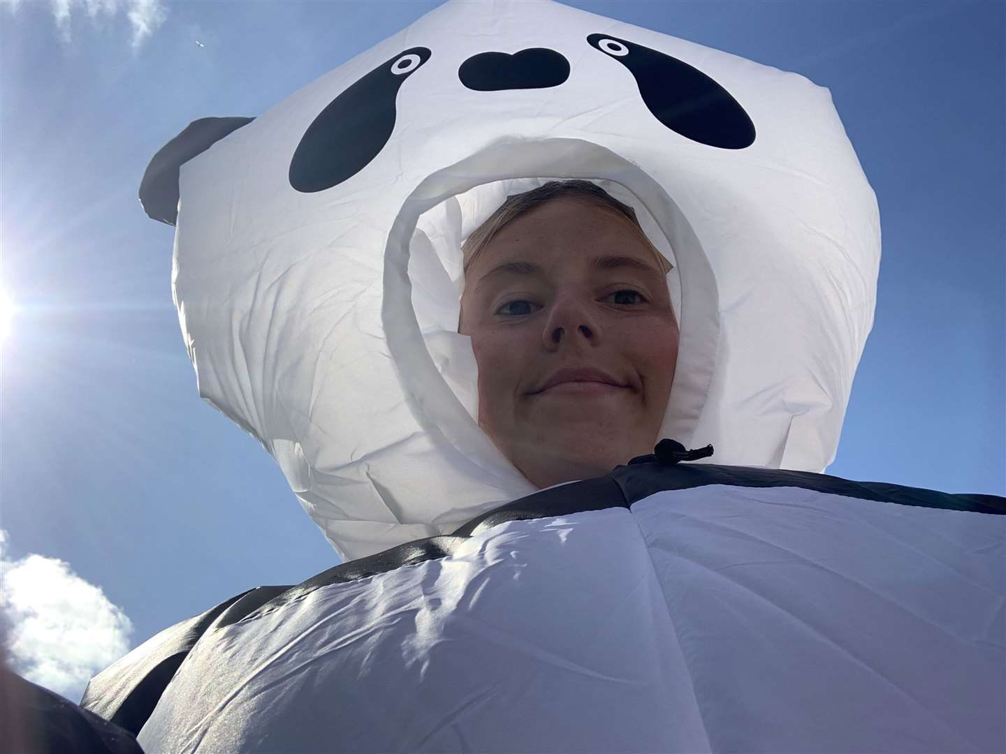 Sammy Stimpson who is wearing an inflatable panda suite while delivering post in Downham Market to raise money for the Mental Health Foundation. Picture: SUBMITTED. (34426873)