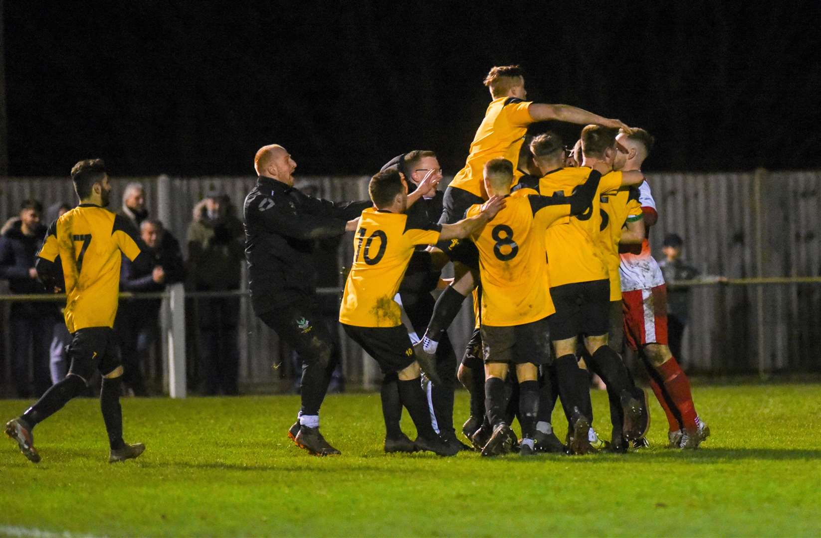 Fakenham players celebrate at the end of the game.. (43637228)
