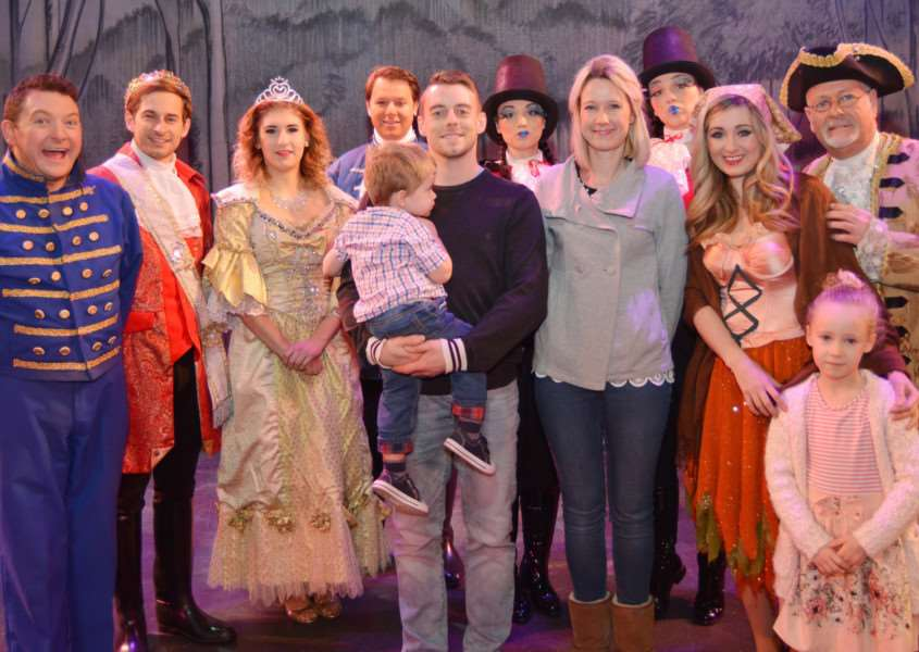 Princess Theatre Panto Competition Winners'Competition winner Tara Bowman with husband, Christian, and children, Joey and Madison, surrounded by the Cinderella cast, from left - Andy Eastwood (Buttons), Simon Hollosi (Prince Charming), Hannah Bird (Fairy Godmother), Adam Tremlett (Dandini), Elise and Seren Whyte (Ugly Sisters), Helen Farrell (Cinderella) and Mervyn Francis (Baron Hardup)