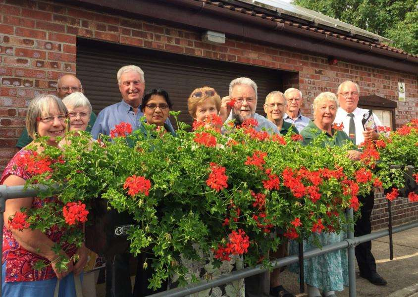 South Wootton in Bloom committee members with Anglia in Bloom judges George Dawson, centre, and David White, far right.