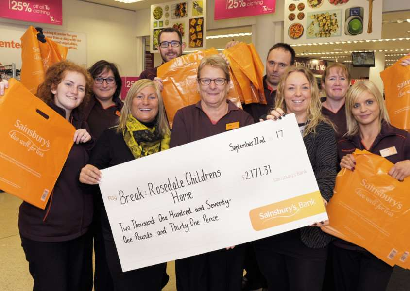 Sainsburys Town Centre Store presenting a cheque for �2,171.31 (From Plastic Bag Sales) to the Break Charity's Rosedale Children's Home in KL'Front LtoR, Caitlin Waterfield (Sainsbury KL), Teresa Ovenden (Support Worker Break), Janet Todhunter (Sainsbury KL) Katie Mathunjwa (Deputy Manager Break), Kayleigh Baxter (Sainsbury KL), along with other staff member at the Town Centre Store