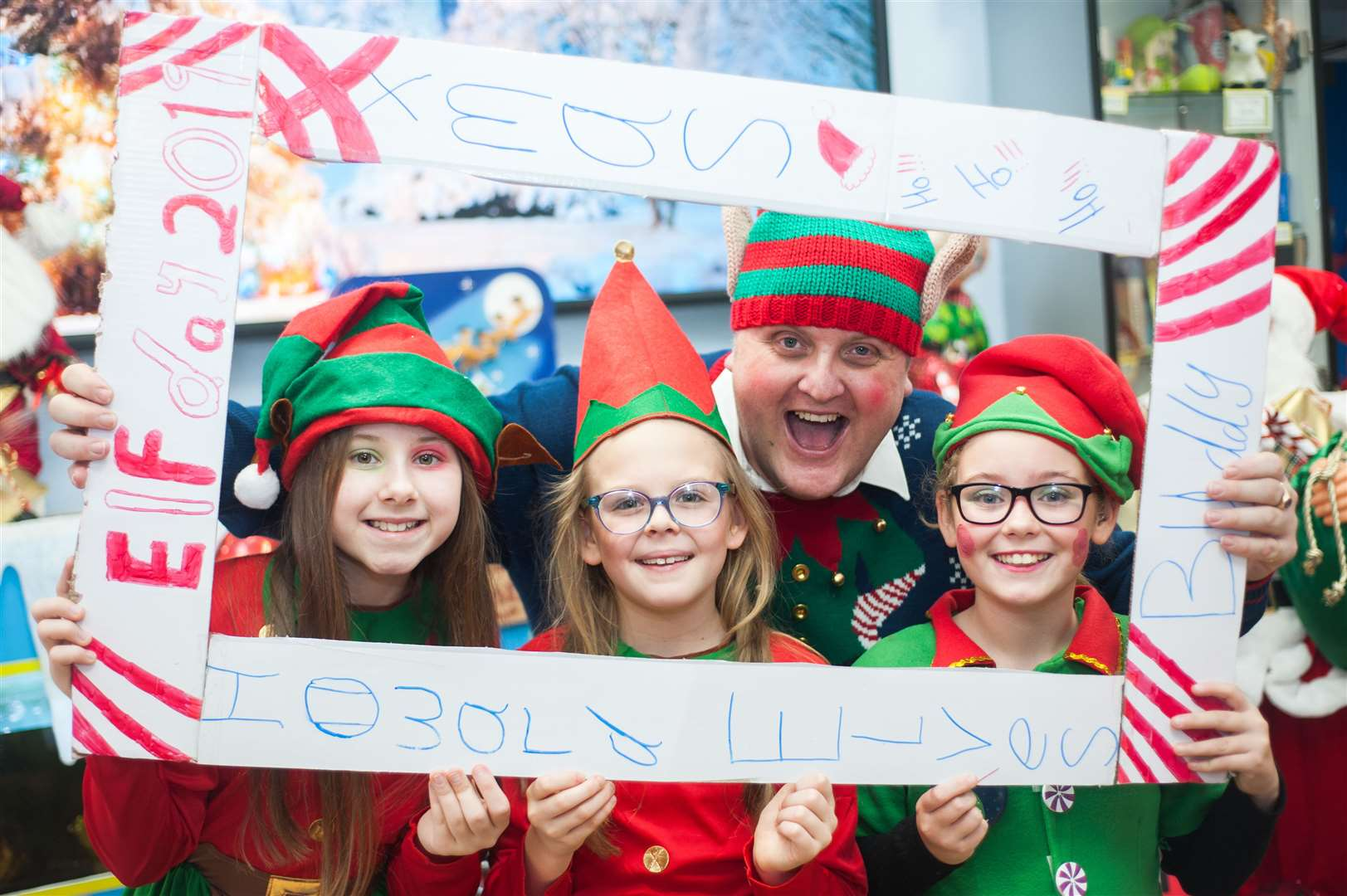 Howard Junior School Head Teacher Greg Hill with pupils on Elf day