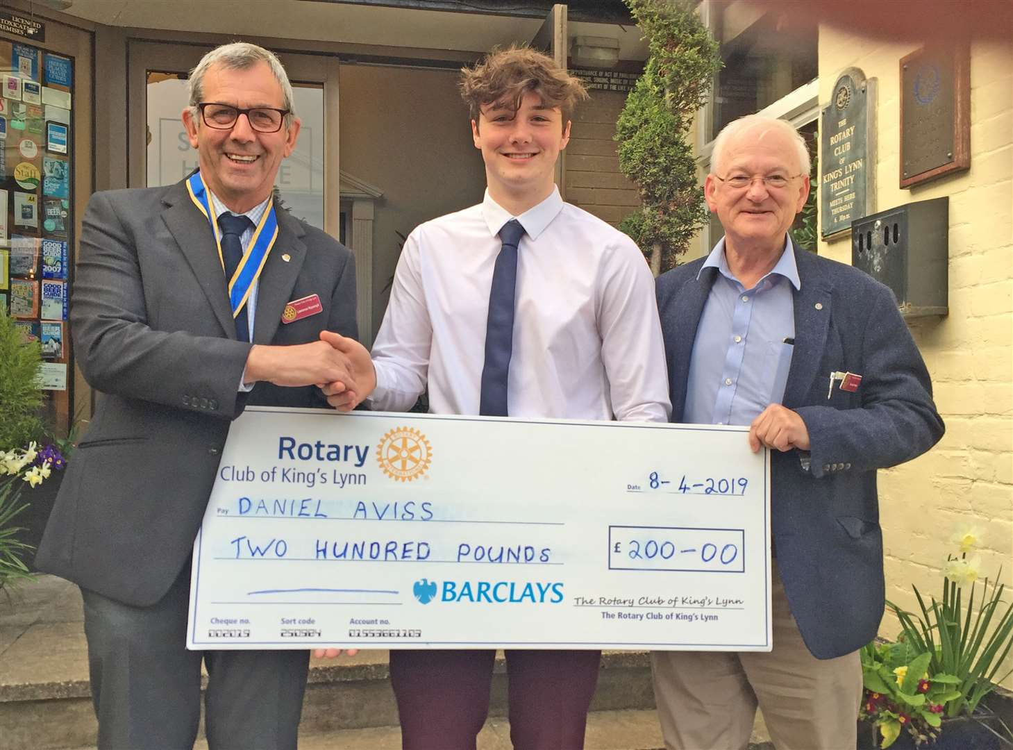 The attached photograph was taken at the Stuart House Hotel on Monday 8th April at a regular meeting of the R.C. of King 's Lynn. From the left: Rotary Club President , Pip Rippengill - K.E.S. Student, Daniel Aviss - Rotary Club Vocational chairman, Richard Waite, the cheque in for £200 (8425242)