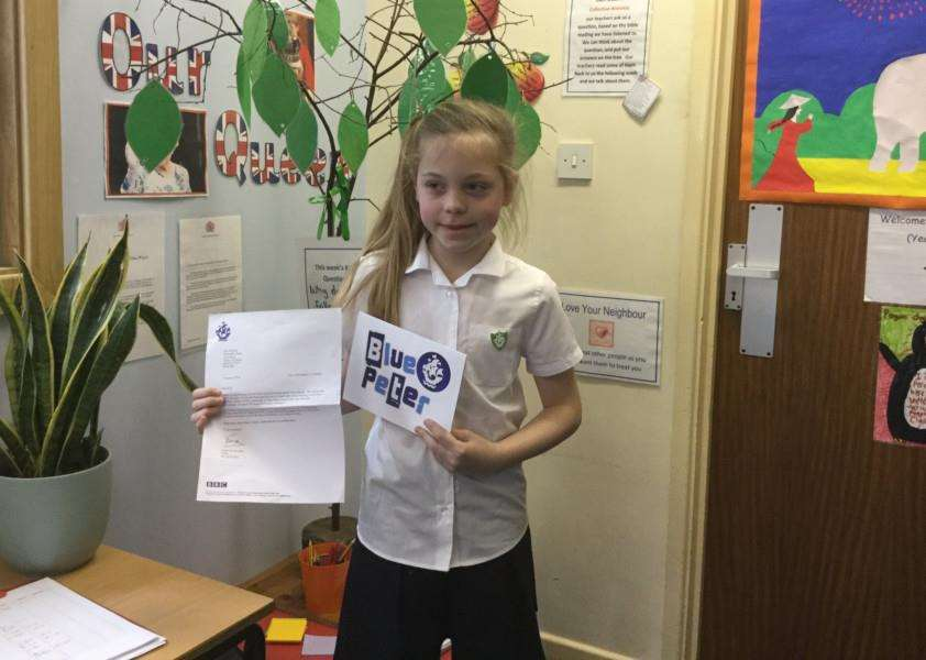 10-year-old Lily Dickson with her Blue Peter badge
