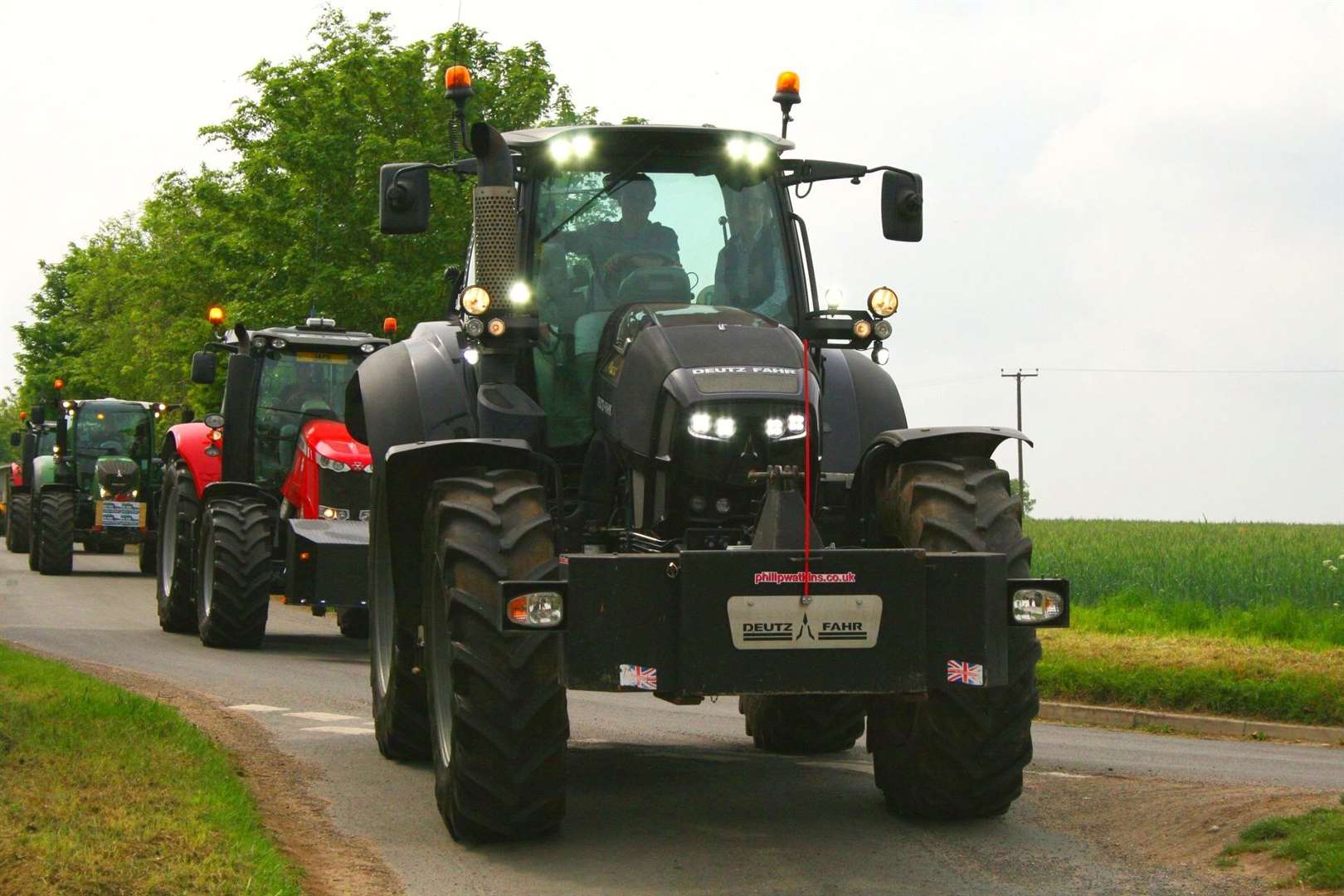 Some of thenewer tractors on the Methwold run (11453108)
