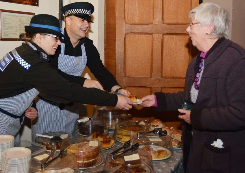 FAKENHAM CHURCH CHRISTMAS TREE FESTIVAL'Double shift - on duty police donned aprons to help out. PC Rich Dawson and PCSO Jo Rowbotham serve Diane Stanley