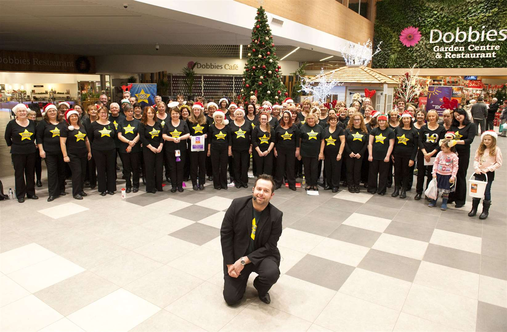 West Norfolk Rock Choir previously performed at Tesco Hardwick King's Lynn.  Pictured is Mike Tandy with choir
