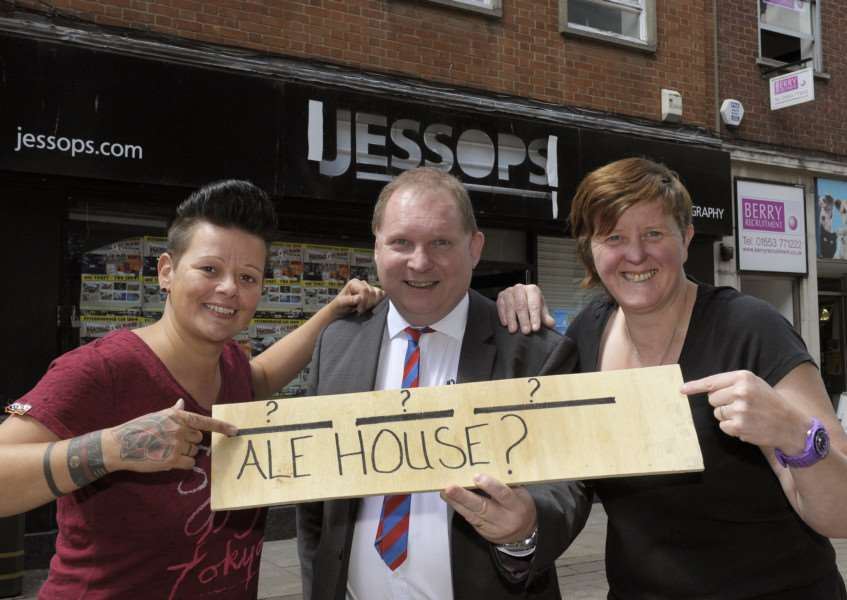 New Ale House Competition King's Lynn'LtoR, New owners Elise Rout (left) and Clare Biggs (right) with Lynn News Editor Mark Leslie, in front of the former Jessops shop in High Street.