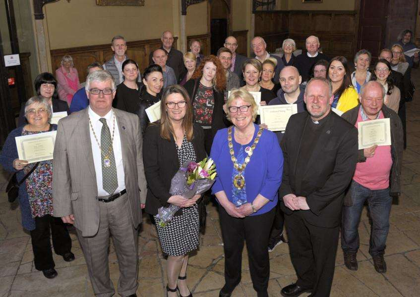 Borough Mayor Hosts a Reception for The King's Lynn Night Shelter Volunteers at the Town Hall 'Front left to right, Simon Bower (Mayor's consort), Joanne Dowen (Night Shelter Co-ordinator), Mayor Carol Bower, Father Adrian Ling, with other guests attending the event.