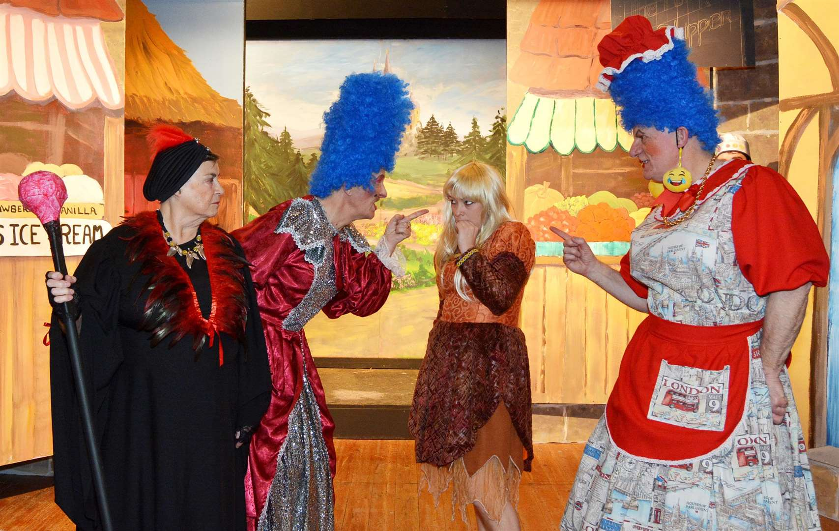 Evil Baroness Griselda (Joan Price) looks on as Ugly Sisters Richard Tree (Bella-Needs-a-Fella Hardup) and Robin Hawkes (Stella Artois Hardup) torment Mel Smyth (Cinderella) (Nccd0007) (6533078)