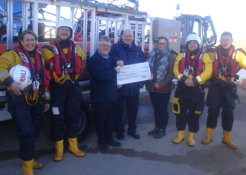 Hunstanton RNLI lifeboat operations manager Robin Rafferty accepting a cheque alongside other crew members