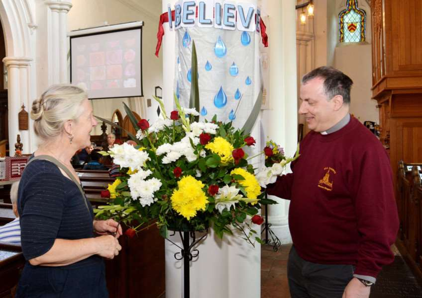 NECTON CHURCH FLOWER FESTIVAL'Church Warden, Helen Lewis and rector the Rev Stephen Thorp admire a floral tribute to Elvis Presley's Gospel song, I believe, part of his 1957 Christmas album