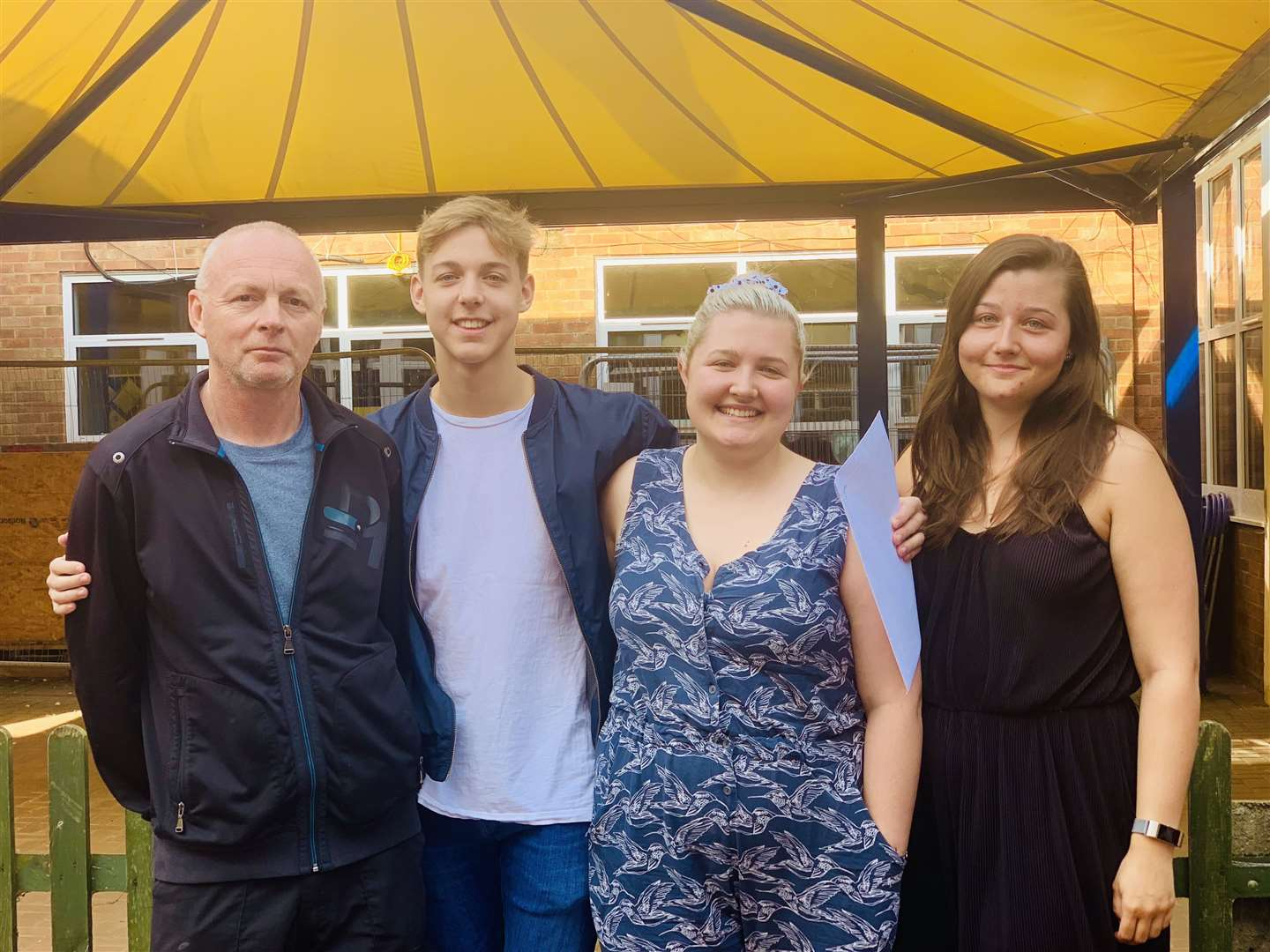 Downham Market Academy GCSEs 2019: Alife Randall, second from left, with stepfather Max Lincoln, and sisters Lilly and Alice Young (15607932)