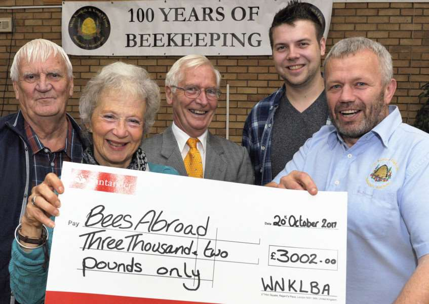 West Norfolk and King's Lynn Beekeepers Association 100 years Birthday.'Special Cheque presentation for the Bees Abroad Project, LtoR, Pat Duhig (Tres), Venetia Rist (project organiser), Stuart Grant, Lee Chapman, Peter Davies (Chairman)