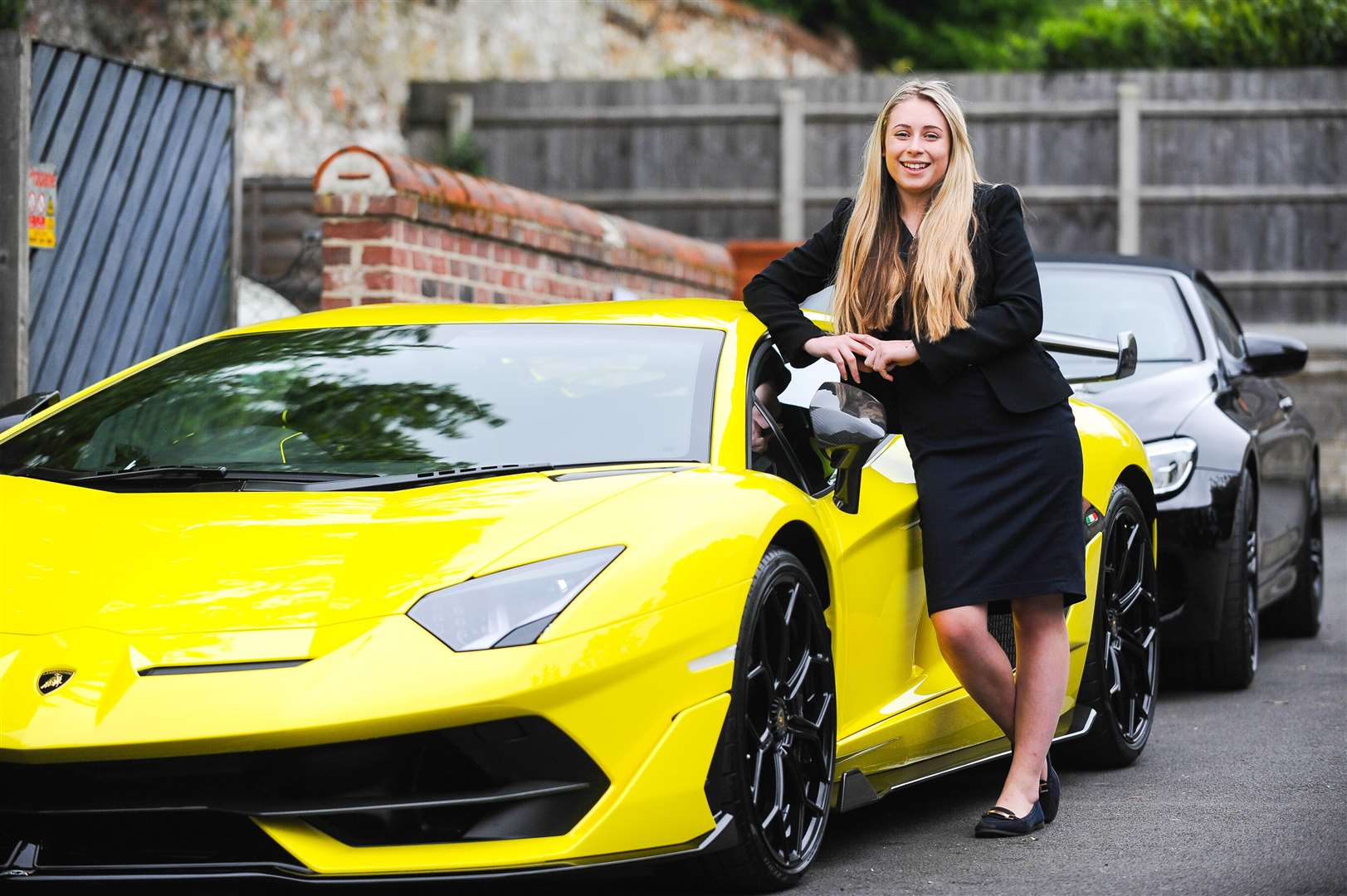 Kelsey Read with one of the event's prize winners - the Lamborghini Aventador SVJ