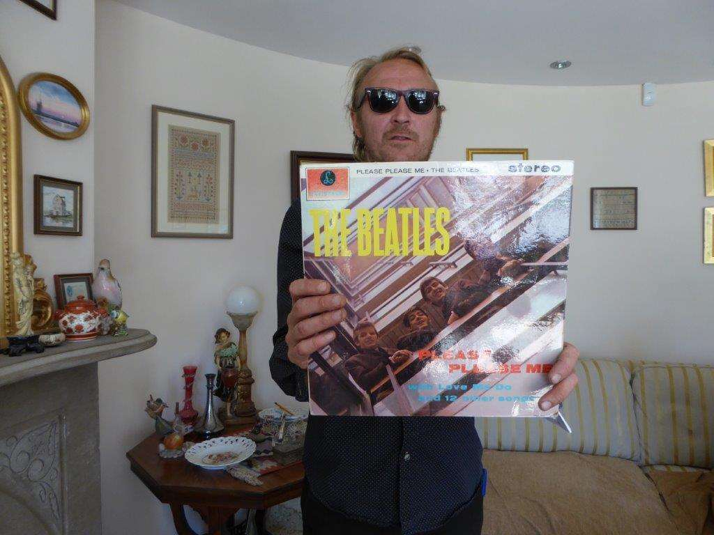 Auctioneer and co-owner of Methwold Auction Steven Tyman with the record Please Please Me by The Beatles. Photo: SUBMITTED. (2894758)