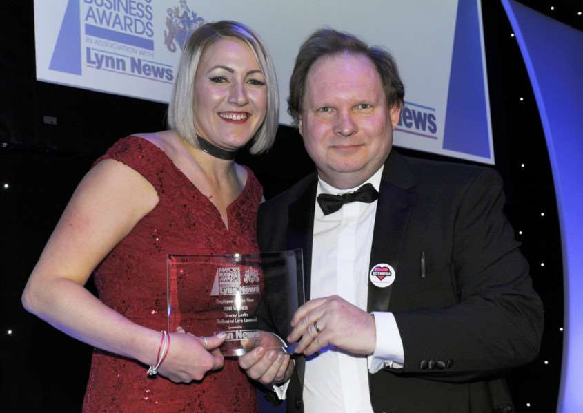 Editor of Lynn News Mark Leslie presenting Stacey Locks of Dedicated Care Ltd with the Employee of the Year award