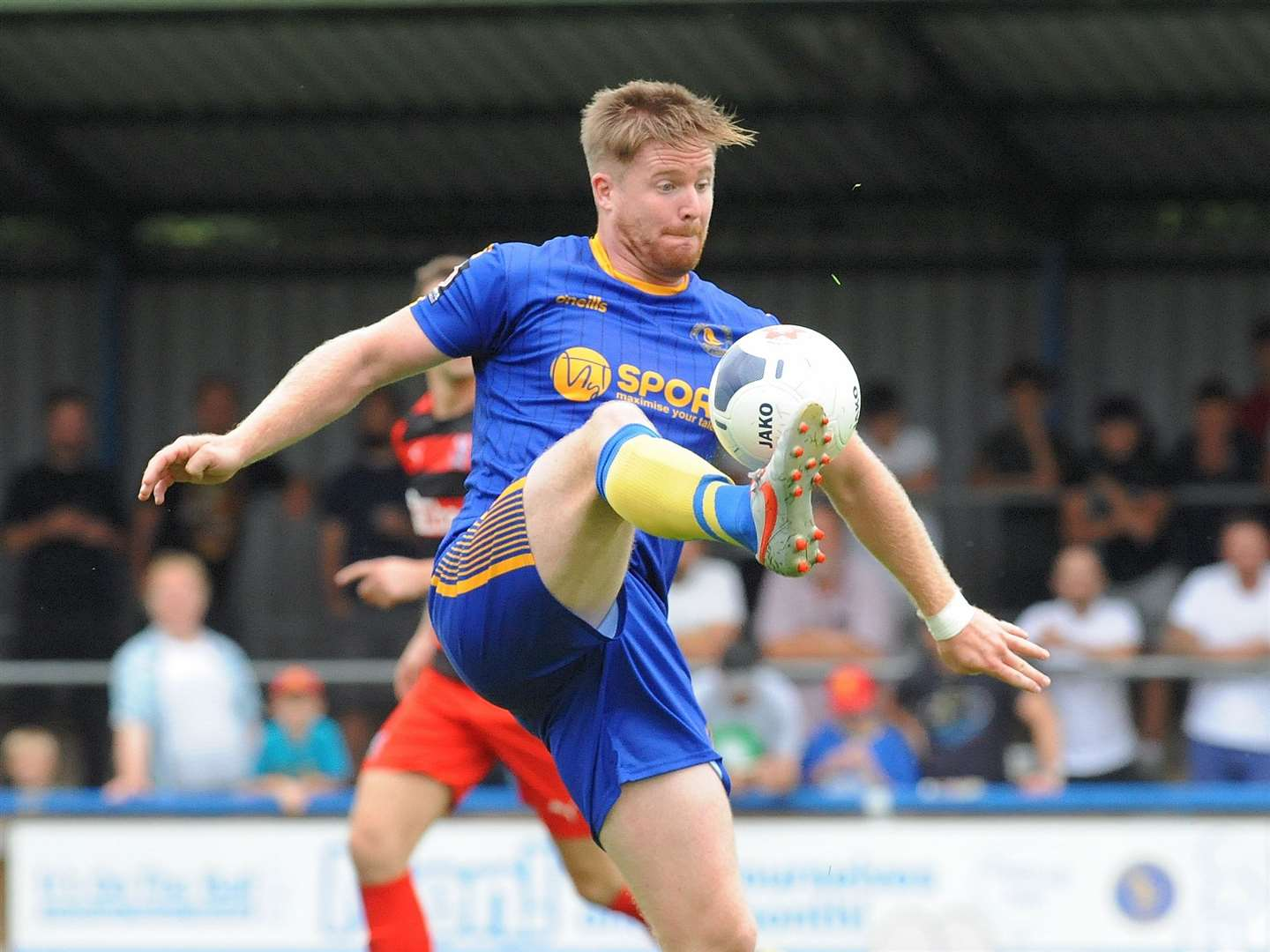 Linnets striker Michael Gash shows his strength. (16002329)