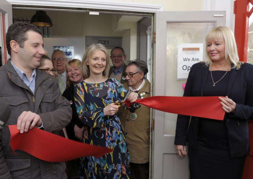 Elizabeth Truss MP cuuting the Tape to officially open the New Platform One Cafe at Downham Market Railway Station''LtoR, Darren Sutton, Elizabeth Truss MP, Angela Palmer (Route Manager Great Northern)