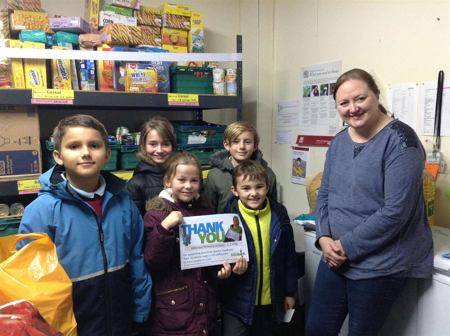 Hillcrest Primary School pupils at the food bank are, from left, Alex Easter, Isla Sivell, Ryan Minns, Millie Pepper, Freddie Pepper with Alex Coates from Downham Market food bank. Picture: SUBMITTED. (6122620)