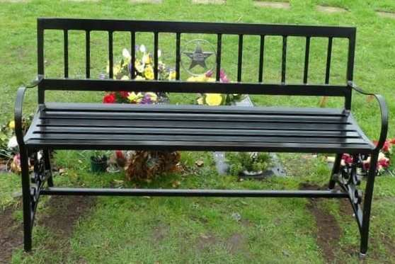 A memorial bench to Matthew Hunt in St Clements Church graveyard - the metal star plaque was stolen from the bench last month. Photo: SUBMITTED.